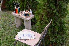 Photo Materials drawing and chair on which lying pencil sketches Royalty Free Stock Photo