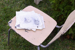 Photo Materials drawing and chair on which lying pencil sketches Royalty Free Stock Photos