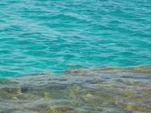Crystal clear turquoise water on rocky bottom royalty free stock image