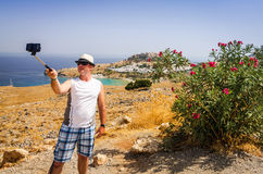 Photo memory from tropical vacation. Man taking selfie photo in vacation scenery royalty free stock photo