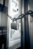 Photo of metal lock hanging on refrigerator door Stock Photo