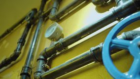 The photo of metal pipes for water supply. With gate for opening and closing stock footage
