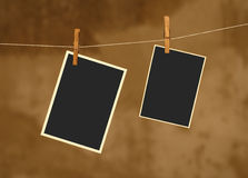 Photo on metal rope with wood Clothespins Stock Photos