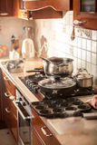 Photo of metal saucepan boiling on stove Royalty Free Stock Photography