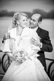 Photo of mid-aged groom hugging bride from back Royalty Free Stock Images