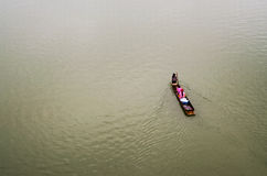 Photo minimalist, Lifestyle Sagklaburi. Way of life of People paddle in the river's at Sangkhla Buri District, Karnchanaburi province stock photography