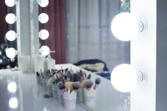 Photo of the mirror in the make-up room. Large lamps near the mirror royalty free stock photography