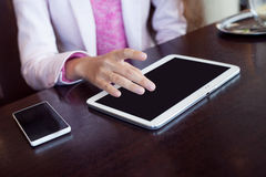 Photo  mockup.  girl works on the digital tablet Royalty Free Stock Photo