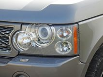 Modern front car vehicle headlight details lights design. Photo of a modern car showing details to front headlamps lights cluster ideal for manufacturing etc royalty free stock images