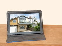 Buying selling property online internet. Photo of modern home property architecture on tablet mobile device depicting buying and selling online royalty free stock photo