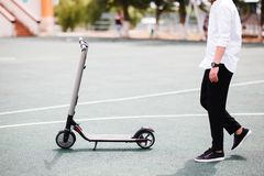 Photo of modern man with electric scooter at the street royalty free stock image