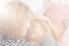 Photo of mom and daughter. Bright photo of mom and little daughter spending time together royalty free stock image