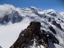 Mont Blanc and the clouds are coming. Photo of Mont Blanc was taken from Aguille du Midi few minutes before it was fully covered by the clouds Royalty Free Stock Image