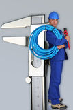 Plumber next to giant calliper Stock Photography