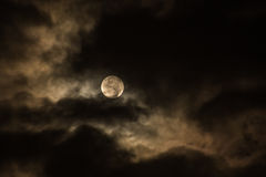Photo of Moon Covered by Dark Clouds during Night Time Royalty Free Stock Image