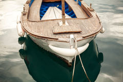 Photo of moored old white wooden boat Royalty Free Stock Photos