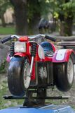 Photo of a motorcycle toy in a children's play area. Stock Image