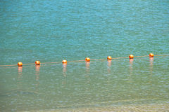 Photo of a mountain lake with buoys Stock Photography