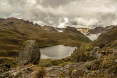 Mountain lake stone. This is a photo of a mountain lake with a stone in the foreground, taken in national park cajas, Ecuador stock photography