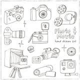 Photo and movie hobby cameras. Stock Photography
