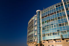 The photo of multistory building, shot on the wide lens with PL filter, in the sunset light Royalty Free Stock Photos