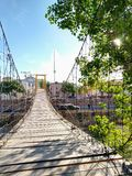 Suspension bridge on sunny days royalty free stock photography