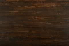 Photo of natural wood for background or texture, dark brown color Royalty Free Stock Photos