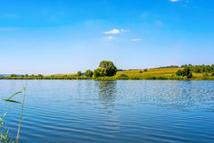 Photo of nature around beautiful blue lake. At summer Royalty Free Stock Image