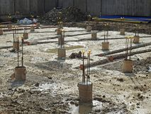 New build construction site. Photo of new build construction site showing support pillars and channels dug out for drainage etc Royalty Free Stock Images