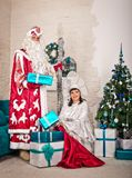 Photo on a New Years card for congratulations 1505. Father Frost and the Snow Maiden give gifts stock image
