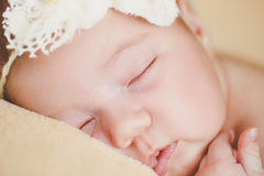 Photo of a newborn baby curled up sleeping on a blanket Royalty Free Stock Photo