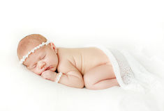 Photo of a newborn baby curled up sleeping on a blanket Royalty Free Stock Photos