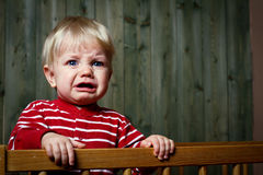 Photo of nine month baby crying. Crying baby do not want to sleep Stock Images
