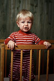 Photo of nine month baby crying. Crying baby do not want to sleep Royalty Free Stock Images