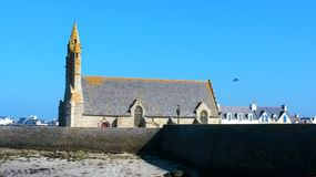 Church by the sea at low tide - Finistere stock image