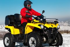 Free Photo Of Attractive Young Man In Red Warm Winter Clothes And Black Helmet On The ATV 4wd Quad Bike Stand In Heavy Snow Stock Images - 139750854