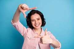 Free Photo Of Beautiful Cheerful Lady Short Black Hairdo Hold Arms Hands Fingers Making Imagination Focus Cadre Photographer Stock Photography - 189936262
