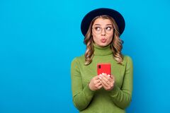 Free Photo Of Cheerful Curly Lady Hold Telephone Popular Blogger Think Over New Creative Post Look Up Empty Space Wear Specs Royalty Free Stock Images - 181692839