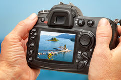 Photo Of Church And Sea On Camera Display During The Summer Vacation. Travel Photography Royalty Free Stock Photography