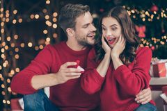 Free Photo Of Couple In Decorated Garland Lights Room Guy Giving Lady Unexpected Engage Ring Box Waiting Answer Sitting Cozy Stock Photos - 161086413