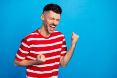 Free Photo Of Crazy Happy Young Man Raise Fists Close Eyes Fan Support Win Isolated On Pastel Blue Color Background Stock Images - 220795154