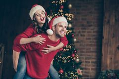 Free Photo Of Cute Couple Spending X-mas Eve In Decorated Garland Lights Room Carrying Piggyback Holiday Mood Indoors Wear Stock Images - 161086144