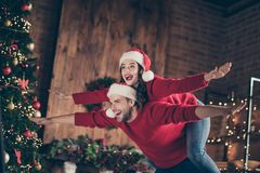 Free Photo Of Funny Couple Spending X-mas Eve In Decorated Garland Lights Room Guy Carrying Lady Piggyback Pretending Flight Royalty Free Stock Photo - 161086115
