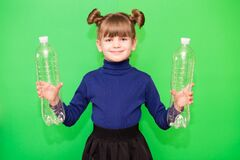 Free Photo Of Funny Little Girl Holding Plastic Bottles And Looking At Camera Isolated Over Green Background Royalty Free Stock Image - 188615626