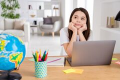 Free Photo Of Little School Girl Wait Notebook Online Lesson Conference Minded Think Over Summer Holidays Vacation Sitting Royalty Free Stock Photo - 182966875