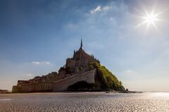 Free Photo Of Mt St Michel In Normandy France In The Afternoon With A Sunstar Stock Photos - 186140333