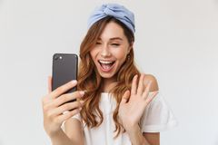Free Photo Of Pretty Cute Woman 20s Smiling And Waving Hand At Camera Royalty Free Stock Images - 124034149