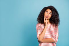 Free Photo Of Pretty Dark Skin Lady Looking Empty Space Wondered Think Over Philosophy Questions Wear Casual Striped Sweater Royalty Free Stock Photos - 160568818
