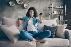 Free Photo Of Pretty Dark Skin Wavy Lady Homey Mood Holding Tv Remote Control Changing Channel Searching Favorite Humor Show Stock Photo - 163082880