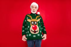 Free Photo Of Santa Granddad Showing Ugly Deer Ornament Pullover Dressed On Himself Not Understand Idea Of Costume Theme X Stock Images - 160285594